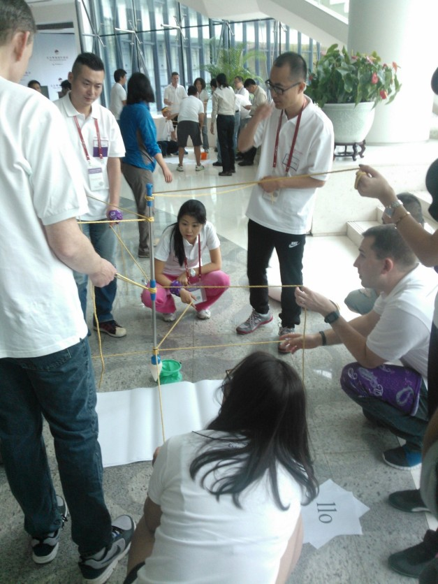 """Students broke the ice in orientation week during team building exercises. Pictured is the """"big pen,"""" which required multiple operators and plenty of teamwork."""